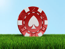 Chip Of Casino On Grass (clipping Path Included) Royalty Free Stock Image