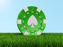 Chip Of Casino On Grass (clipping Path Included) Stock Photography