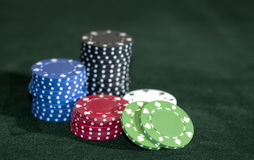 Chip Pile. A group of red white blue green and black poker chips Royalty Free Stock Photography