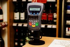 Chip and pin machine. Modern Chip and Pin machine in a liquor store Royalty Free Stock Images