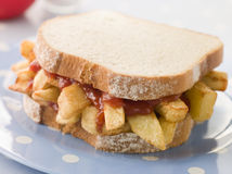 Chip Sandwich on White Bread with Tomato Ketchup Stock Photo