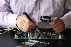 Chip soldering man hands Stock Photo