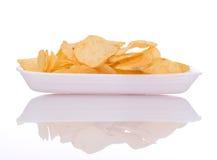 Chip sul piatto Fotografie Stock
