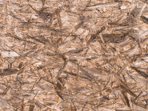 Chipboard Wood Abstract Background. Section of unpainted  brown chipboard - abstract background Royalty Free Stock Images