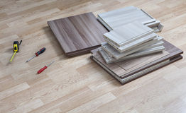 Chipboard for assembly furniture lying on floor next to screwdri Royalty Free Stock Photography