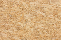 Chipboard Background. Close-up of pressboard texture background with splinters Stock Images