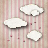 Chipboard clouds on striped background Stock Photos