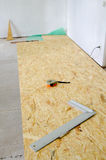 Chipboard floor installation Stock Image