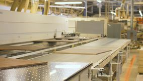 Chipboards on conveyer at furniture factory stock video