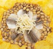 Chiper pistascher, salt fisk, de torkade tioarmade bläckfiskarna Royaltyfria Bilder