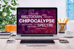 Chipocalypse concept with meltdown and spectre threat on laptop screen in office. Chipocalypse concept with meltdown and spectre threat. Chipocalypse Royalty Free Stock Photo