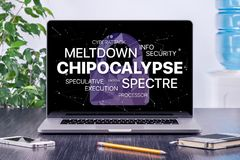 Chipocalypse concept with meltdown and spectre threat on laptop screen in office workspace. Chipocalypse concept with meltdown and spectre threat. Chipocalypse Royalty Free Stock Images