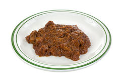 Chipped barbecue pork in gravy on plate Royalty Free Stock Image