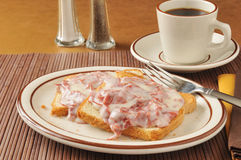 Chipped beef on toast. Chipped beef with gravy on toast with a cup of coffee stock photo