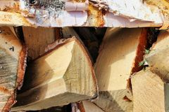 Chipped birch woodpile with bark royalty free stock images