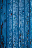 Chipped blue paint wall texture Stock Photography
