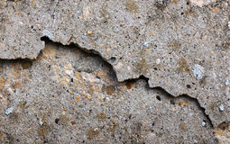 Chipped and broken smooth concrete surface Stock Photos