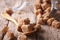 Chipped brown cane sugar macro in a wooden spoon. horizontal Royalty Free Stock Photo