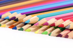 Chipped colored crayons on white background Royalty Free Stock Images