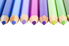 Chipped colored crayons on white background Stock Photo