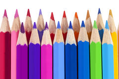 Chipped colored crayons on white background Royalty Free Stock Photo