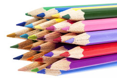 Chipped colored crayons on white background Stock Photography