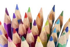 Chipped colored crayons on white background, close up Royalty Free Stock Image