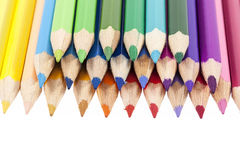 Chipped colored crayons on white background, close up Royalty Free Stock Images