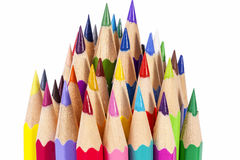 Chipped colored crayons on white background Royalty Free Stock Photography