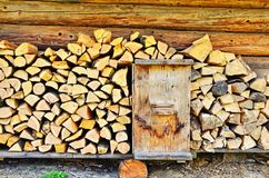 Chipped firewood near a wall royalty free stock photos
