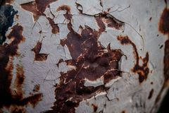 Chipped and flaking paint off rusted and weathered metal. Background or texture or overlay stock photo