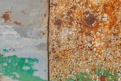 Painted iron surface with a large rusty and metal corrosion, chipped paint, old background with peeling and cracking paint texture. Chipped paint, grunge metal Royalty Free Stock Photos