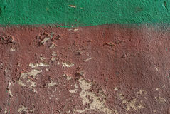 Chipped paint on an old plaster wall texture background Stock Photography