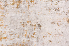 Chipped paint on old wall background. Old cement plastered wall that has chipped paint Stock Photo