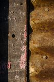 Chipped Paint on Steel Texture - Newport Mill - Newport, Kentucky. Chipped paint on steel texture abuts a corrugated texture at the abandoned Newport Mill in Royalty Free Stock Photos