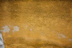 Chipped peeling paint, orange grunge background texture Royalty Free Stock Photos