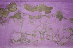 Chipped peeling paint, pink grunge background texture Royalty Free Stock Images