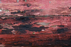 Chipped Red Paint on Old Wood. Background Royalty Free Stock Image