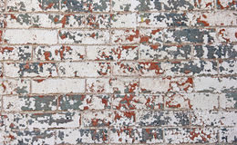 Chipped red white blue paint brick wall Stock Photography