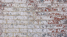 Chipped red white grey blue paint brick wall Stock Photography