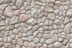 Chipped Stone Wall Background. Extreme closeup royalty free stock photos