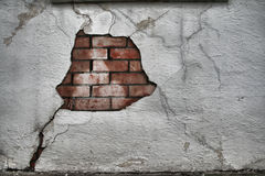 Chipped Wall. A cracked brick wall with old spackling and flaking paint Stock Photography