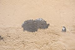 Chipped wall. With a orange paing royalty free stock images