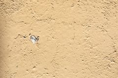Chipped wall. With a orange paing stock photo