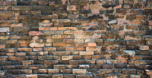 Chipped and weathered old brick wall background Stock Image