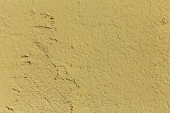 Chipped yellow concrete background Stock Images