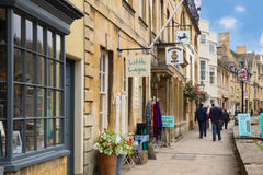 Chipping Campden Cotswolds. Chipping Campden, UK - October 12, 2014:  View of shops along Chipping Campden in the Cotswolds with people walking Royalty Free Stock Photo