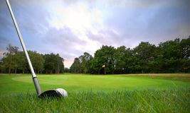 Chipping golf ball onto green Royalty Free Stock Images