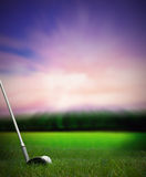 Chipping a golf ball onto the green. Chipping a golf ball with club onto the green from fairway at sunset Royalty Free Stock Photo