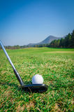 Chipping a golf ball onto the green with driver golf club. Stock Image
